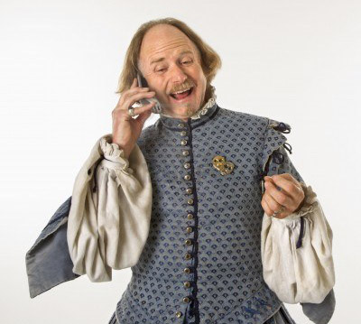2145261-william-shakespeare-in-period-clothing-talking-on-cell-phone